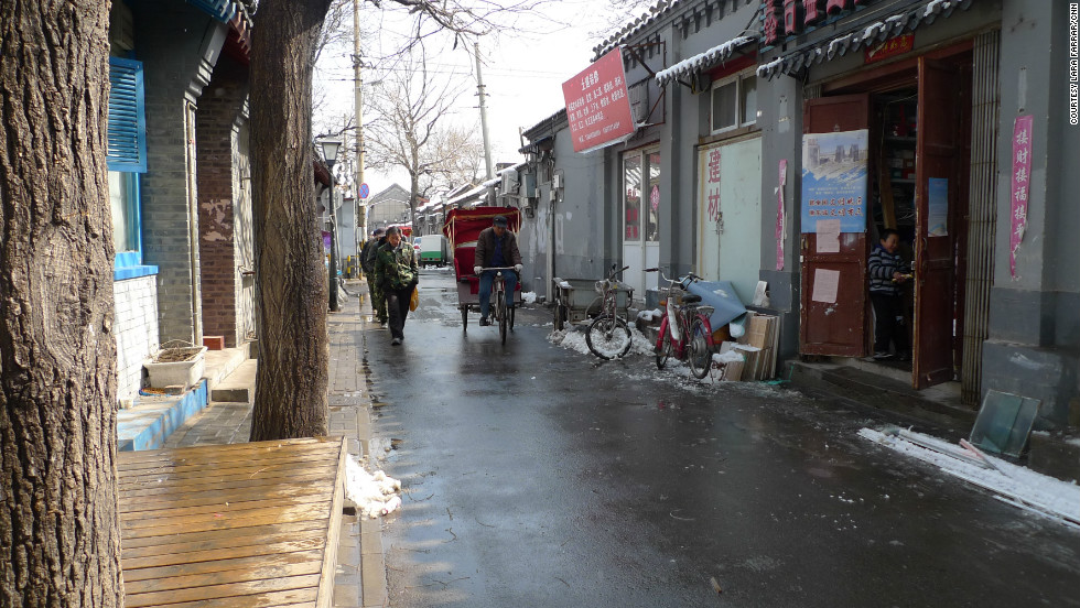 But many places emblematic of old Beijing, including many hutong, Beijing's traditional courtyard housing, are threatened by modernity.  Pictured is a street view of Guowang Hutong, which is located near Beijing's historic Drum and Bell Towers.