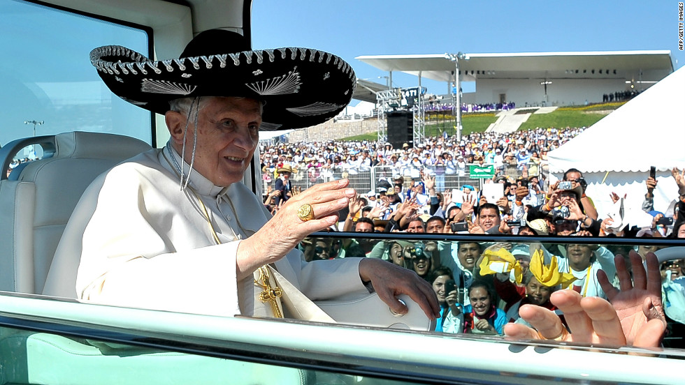 Wearing a large Mexican sombrero, Benedict waves to the crowd.