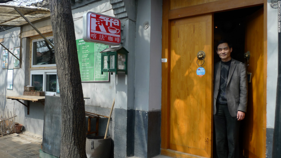 Peter Tan, owner of Kaffa Cafe, one of numerous small coffee shops, restaurants and boutiques hidden in alleyways outside old courtyard homes.