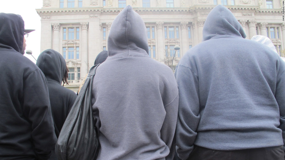 "Hoodie-wearing protesters of all ages descended onto Freedom Plaza in Washington on Saturday for a ""Stand Up for Trayvon"" rally."