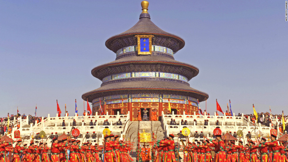 Most tourists know Beijing for the iconic landmarks from its imperial past. Pictured, artists dressed in Qing Dynasty costumes re-enact a traditional ceremony at Beijing's 15th-century Temple of Heaven.