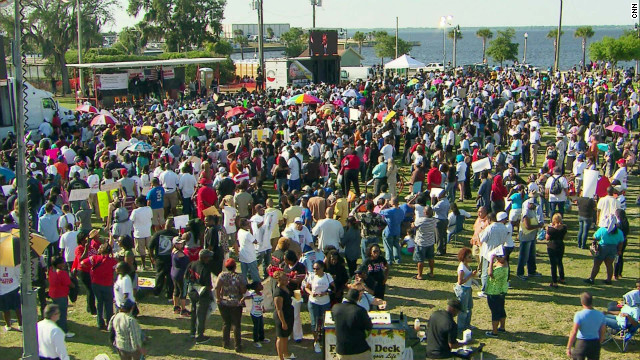 Hundreds of people gather at a park in Sanford, Florida, for a town hall meeting on the shooting of an unarmed youth.