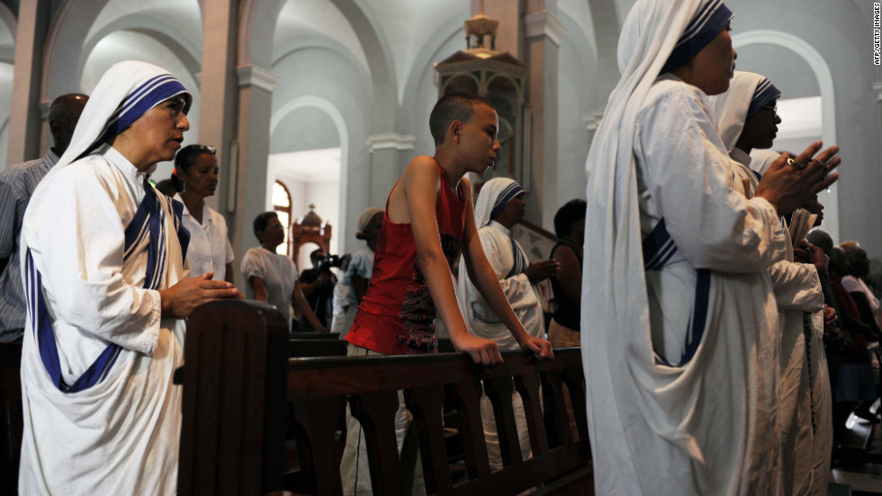 Nuns attend a mass at the Church of Charity in El Cobre, southeast of Havana.  Unlike his visit to Mexico, Pope Benedict XVI is coming to a decidedly not-very-Catholic Cuba, hoping to inspire believers and bring new faithful to the fold.
