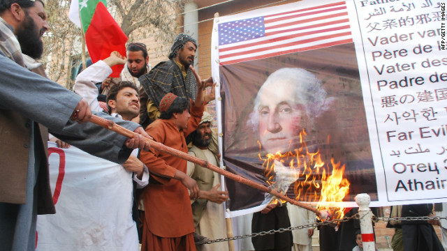 Activists of Awami Majlis Amal burn a picture of first U.S. president George Washington during a protest in Quetta, Pakistan, on March 16.