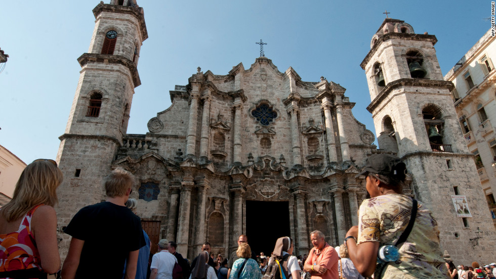 Pilgrims from around the word wait to attend Mass at the Cathedral of Havana.
