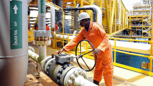 A worker inspect facilities on an upstream oil drilling platform at the Total oil platform at Amenem, 35 kilometers away from Port Harcourt in the Niger Delta. Amenem is the hub of Total oil production with two oil well producing over 100,000 barrels of crude daily.