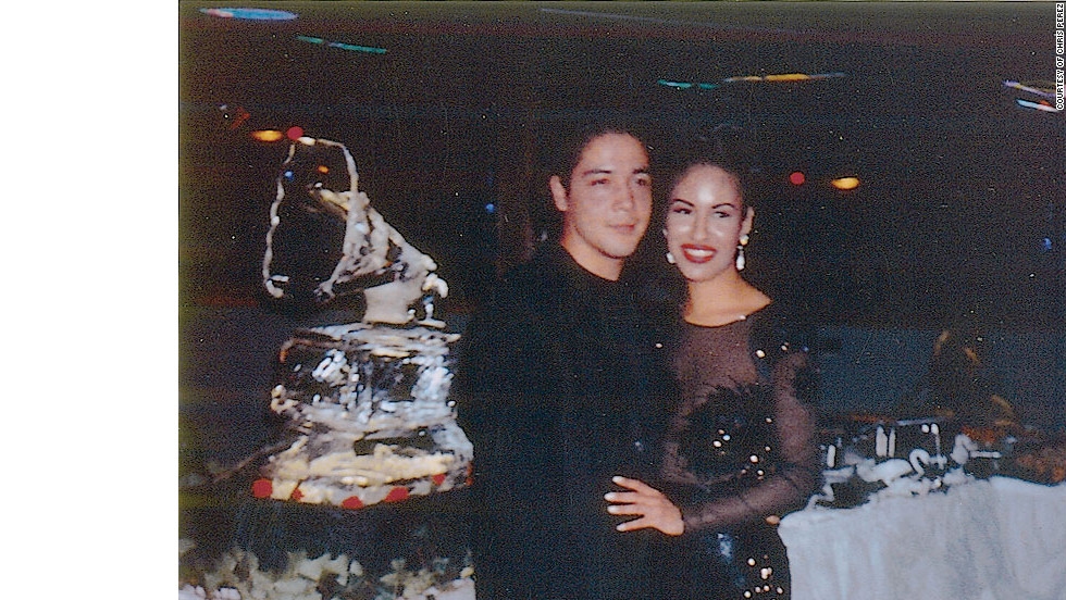 "Selena and her husband Chris at a party to celebrate the winning of the Grammy for the ""Selena Live,"" CD. Selena won the Grammy for Best Mexican-American Album in 1994 and was nominated for Best Mexican-American Performance 1995."