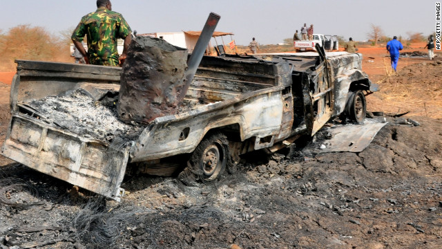 A burnt military vehicle sits where South Sudanese troops and Sudan government forces clashed along the border near Hegleg, the central area for Sudan's oil production.