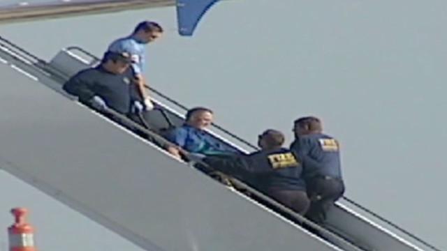 Passengers subdue pilot