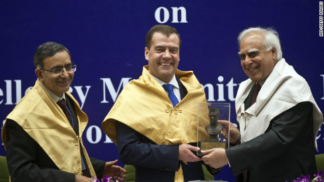 Russian president (C) receives a memento from Indian Minister of Human Resources and Development (R) in New Delhi on March 28, 2012.