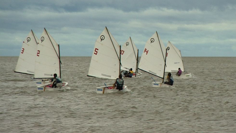 Medal-winning 14-year-old Maria Mabjaia and fellow sailors off the coast of Mozambique's capital, Maputo.