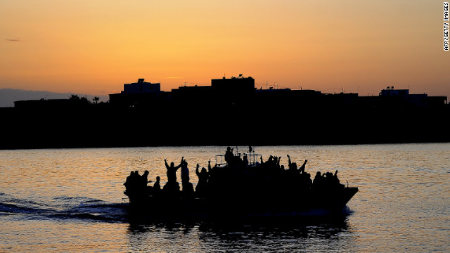 A boat carrying Tunisian migrants enters the port of Lampedusa on April 12, 2011 The island is close to North Africa.