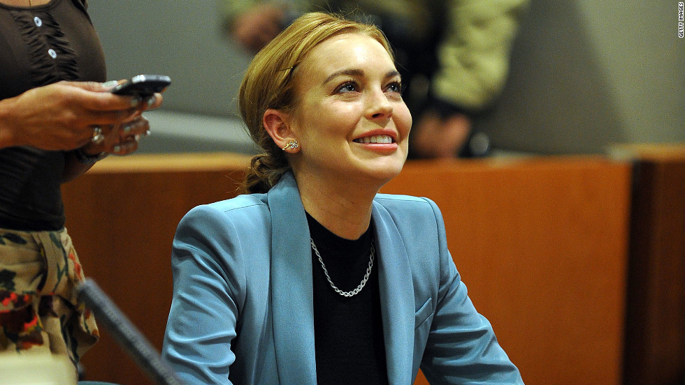 Lindsay Lohan attends her probation hearing at the Airport Courthouse in March 2012 in Los Angeles. Superior Court Judge Stephanie Sautner decided to take Lohan off probation from a 2007 drunken driving case and said that she will no longer have to meet with a probation officer or appear in court on her 2011 shoplifting case, as long as she obeys all laws through May 2014.