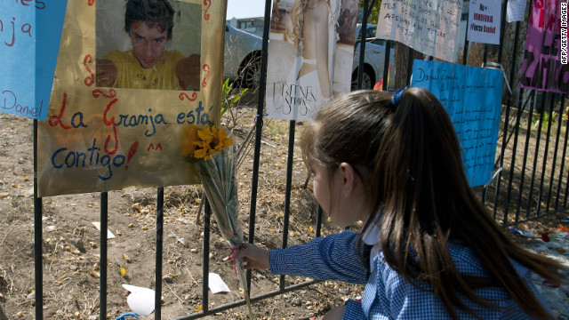 A girl leaves a flower this week next to messages in support of Daniel Zamudio outside a Santiago, Chile, hospital.