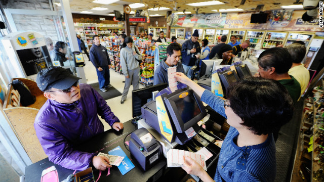 Customers wait in line Thursday to buy their Mega Millions tickets at a liquor store in Hawthorne, California.