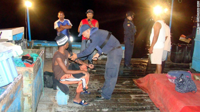 Adrian Vasquez gets treatment after being rescued by the Ecuadorian navy on March 21.