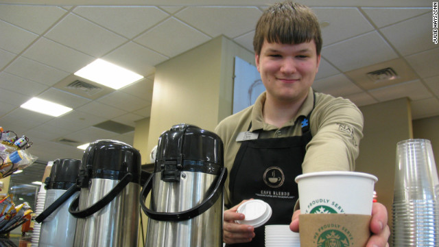 Chris Pavlak stands behind the coffee bar at Cafe Blends.  The cafe is staffed by young adults on the autism spectrum.