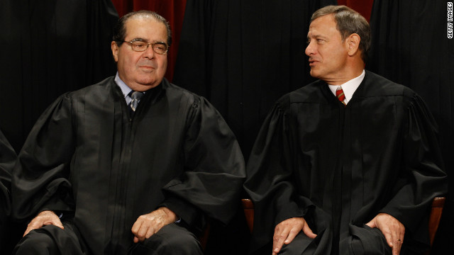 Supreme Court  Associate Justice Antonin Scalia, left, and Chief Justice John Roberts are expected to vote against the mandate.