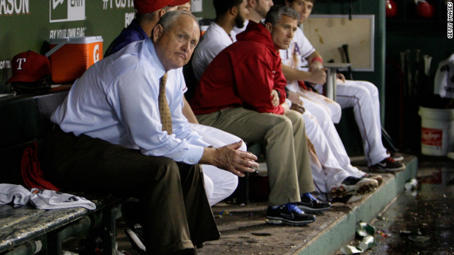 Nolan Ryan looks on from the dugout.