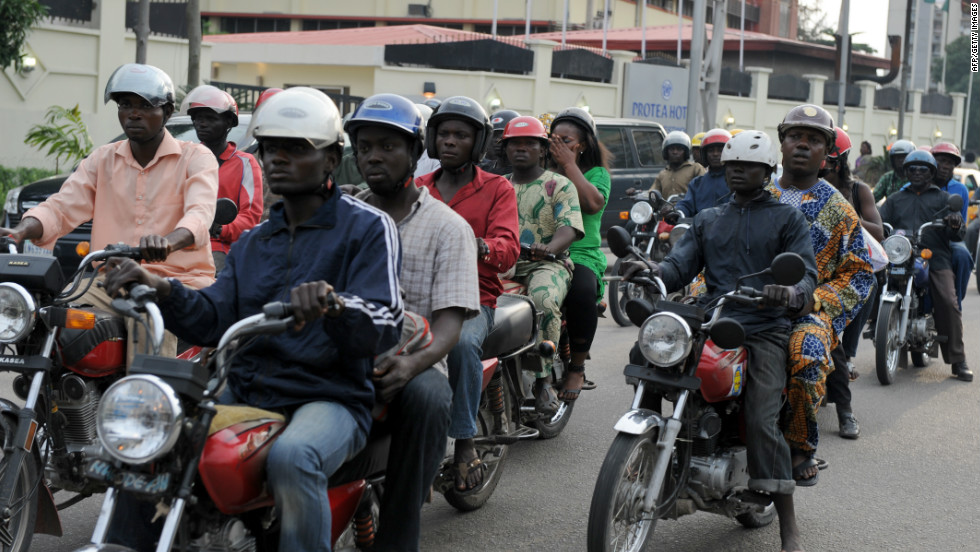 "Riding a motorcycle taxi, also known as ""okada,"" is one of the ways to get around Lagos."
