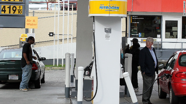 Customers pump gas last month at a Shell station in San Francisco, where prices exceeded $4 a gallon.