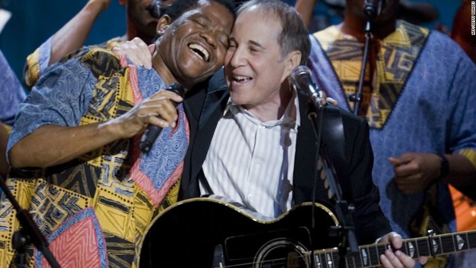 "Founded by Joseph Shabalala (left) in 1960, Mambazo shot onto the world stage in 1986, when they collaborated with American singer-songwriter Paul Simon (center) on the hugely successful ""Graceland"" album. Here, the two are seen performing together at the Library Of Congress Gershwin Prize For Popular Song Gala in Washington, 2007."