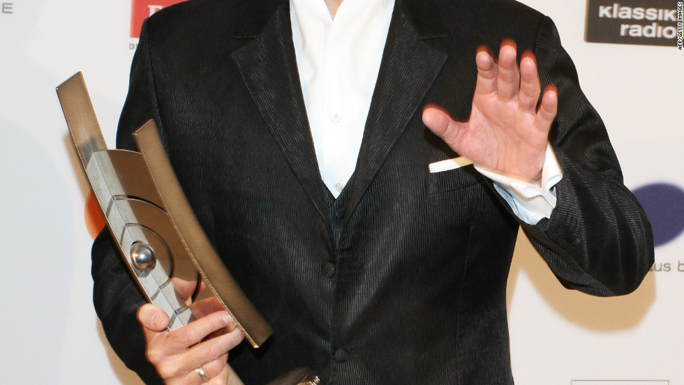 """Hampson has won a litany of awards, including multiple Grammys, two Edison Prizes and the coveted Grand Prix de Disque -- the highest award for musical recordings in France. Here he is pictured clasping the award for """"singer of the year"""" at the 2011 ECHO Klassik awards in Berlin."""