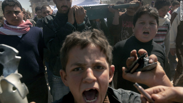 Syrians carry the coffin of a 13-year-old boy who was allegedly killed by regime troops in Sermin in late March.