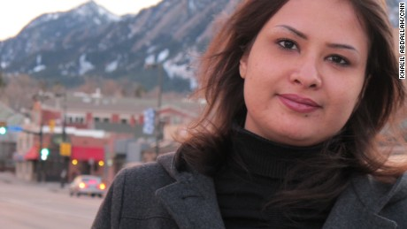 A year after Libyan Eman al-Obeidi stormed into Tripoli's Rixos Hotel, screaming of gang rape by Gadhafi's thugs, she is in Colorado and says she craves anonymity.