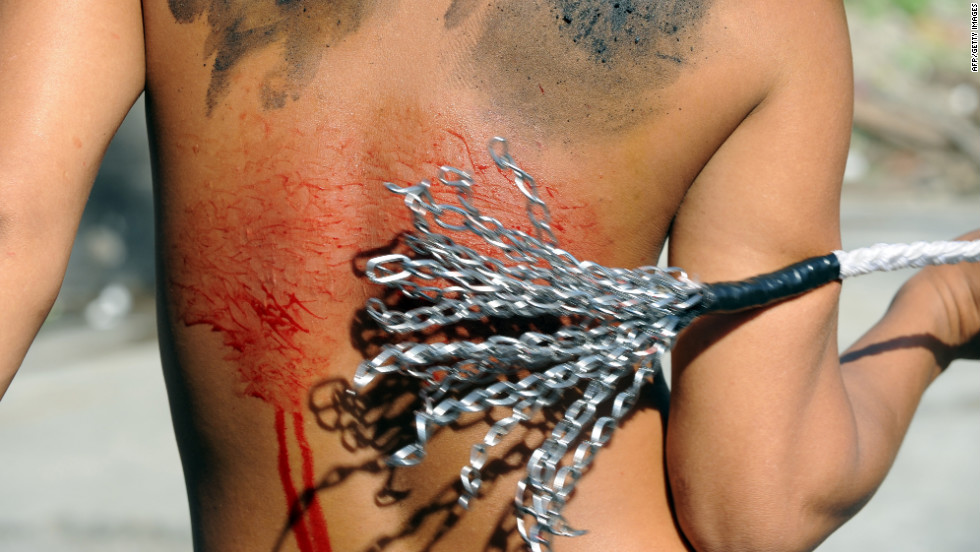 Penitents flagellate themselves as part of a Lenten observance in Manila.