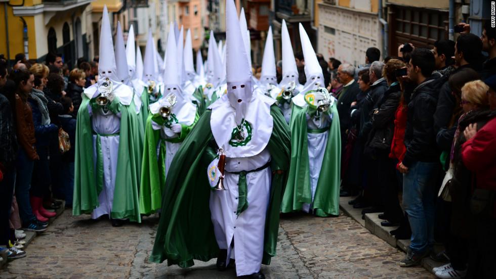 Penitents walk up Calle Balborraz during the Holy Week procession of the Cofradia de la Virgen de la Esperanza (Brotherhood of Our Lady of Hope) in Zamora, Spain.