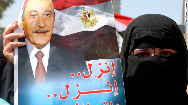 "A supporter of Omar Suleiman holds a poster Friday in Cairo. It says: ""Run, run, don't leave us to the Muslim Brotherhood."""