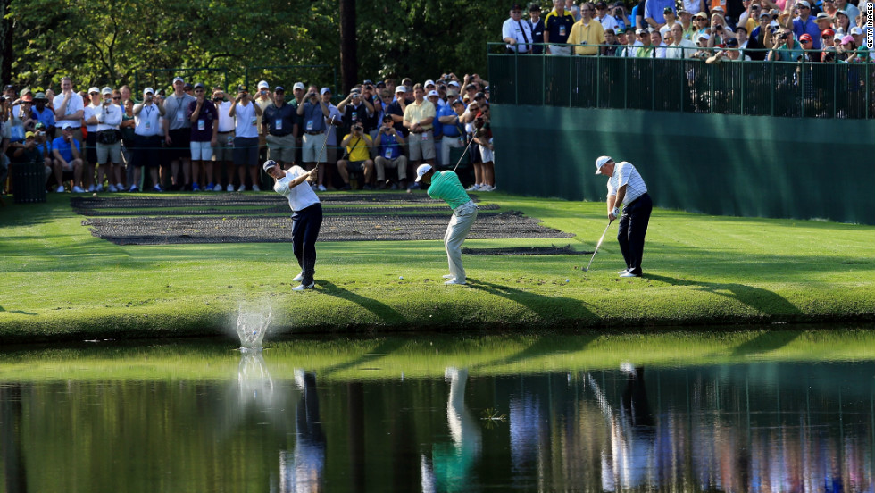 Sean O'Hair, Woods and Mark O'Meara skip their balls over the water during a practice round earlier in the week at  Augusta National Golf Club.