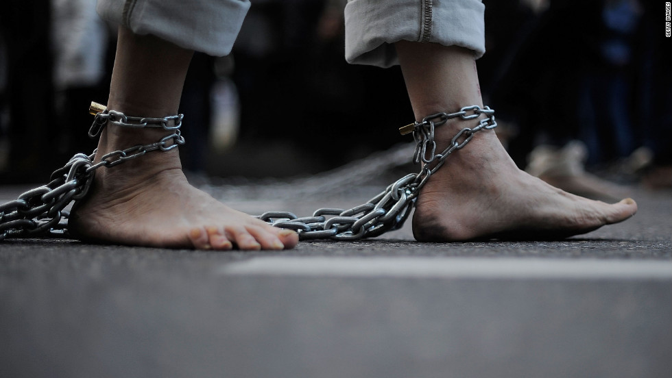 A penitent of the Jesus Nazareno de Medinaceli brotherhood drags chains along the ground during the Holy Week procession Friday in Madrid, Spain. Many regions throughout Spain celebrate Easter week with religious processions.