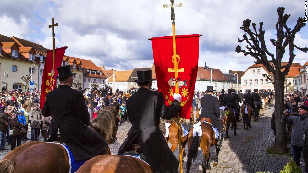 Easter riders parade on horseback on Sunday in Wittichenau, Germany.