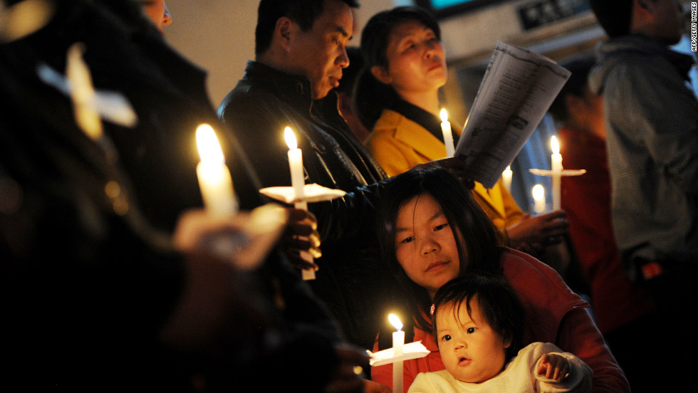 Chinese Catholics pray as they attend an Easter service at the historic South Cathedral in Beijing on Saturday.