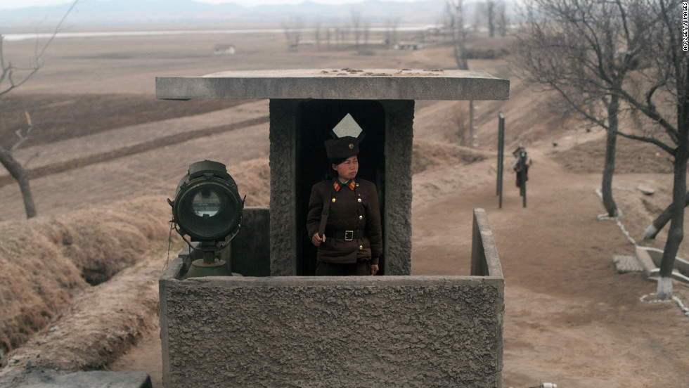 The usually secretive North Korea organised an unprecedented visit for foreign reporters to Tongchang-ri space centre on April 8. During the train journey from Pyongyang to the North Pyongan Province, a journalist took this picture of a North Korean soldier standing at an observation post.