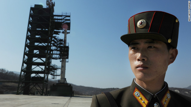 A North Korean soldier stands guard in front of an Unha-3 rocket at Tangachai -ri space center on April 8, 2012. North Korea has confirmed their intention to launch the rocket next week.