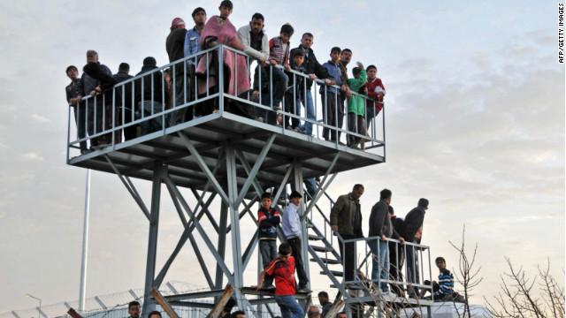 Syrian refugees watch the border from Oncupinar Refugee Camp on April 9, 2012 in Kilis, Turkey.