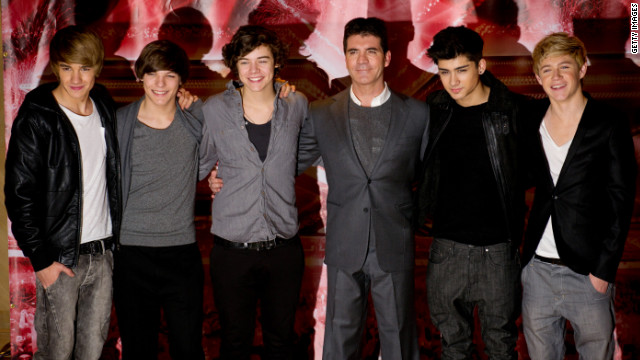 Simon Cowell (center) shown here with One Direction in 2010.
