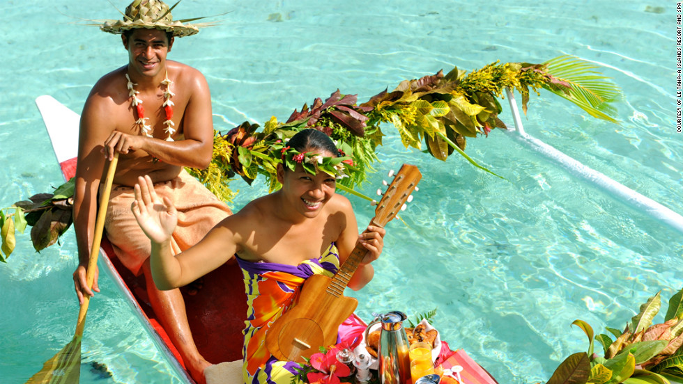 Guests staying at Le Taha'a island resort and spa in Taha'a, French Polynesia can have their breakfast delivered to their private deck by a strumming ukulele player.