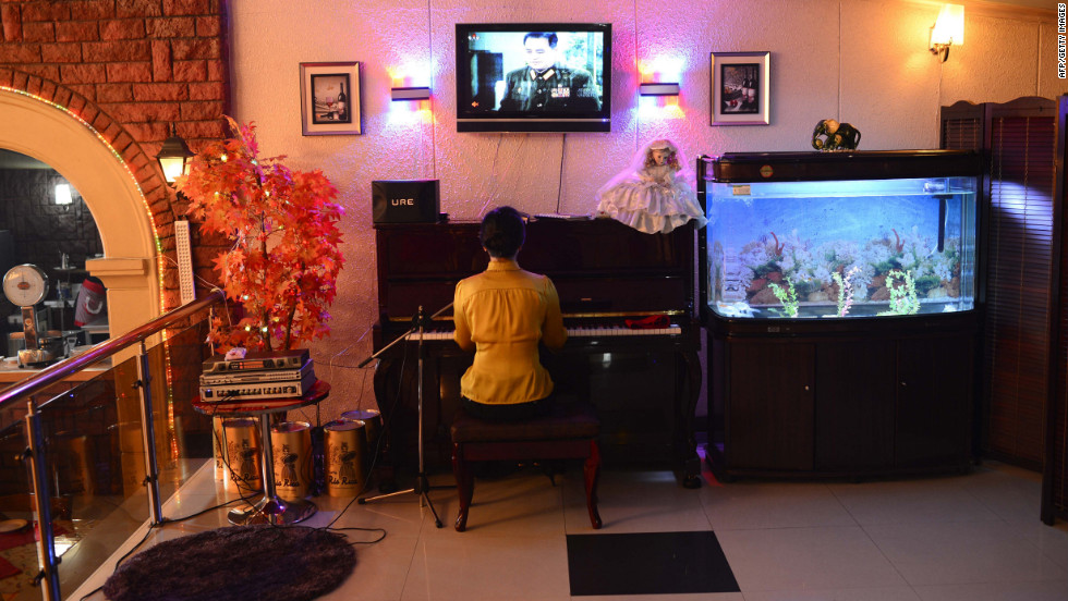 "A woman plays the piano and entertains in a downtown Pyongyang restaurant. U.S. President Obama said the real consequence for North Korea, should it go through with the launch, is that the country's leaders will miss an opportunity. ""I hope that at some point the North Koreans make the decision that it is in their interests to figure out how to feed their people and improve their economy rather than have big parades where they show off weapons,"" he said in March."