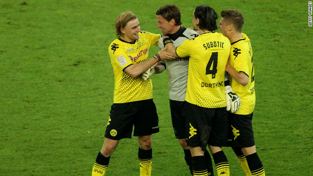 Borussia Dortmund's players celebrate after their vital 1-0 home win over Bayern Munich.