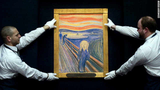 Sotheby's employees pose with Norwegian artist Edvard Munch's 1895 pastel on board version of 'The Scream' at Sotheby's auction house in central London on April 12, 2012. The work is expected to fetch around 80 million USD (around 50 million GBP) when it is auctioned at the Impressionist and Modern Art Evening sale in New York on May 2, 2012.