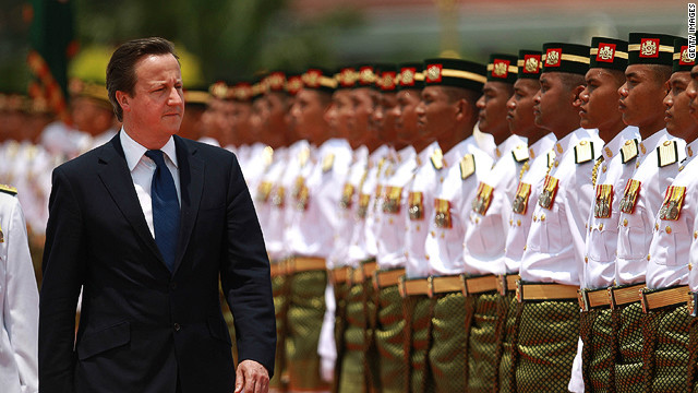 Prime Minister David Cameron inspects a guard of honour at Prime Minister Najib Razak's office on April 12, 2012 in Kuala Lumpur, Malaysia.
