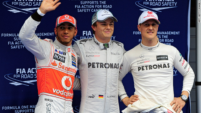 Nico Rosberg (center) flanked by Lewis Hamilton and Michael Schumacher after the qualifying session at the Chinese Grand Prix