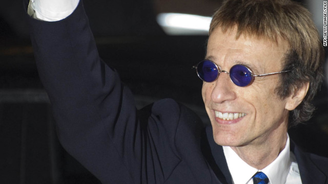 British singer Robin Gibb waves as he arrives for the awardings of the Goldene Kamera 2011 (golden camera media prize) of the Axel Springer Verlag publishing house on February 5, 2010 in Berlin. AFP PHOTO / JOHANNES EISELE (Photo credit should read JOHANNES EISELE/AFP/Getty Images)