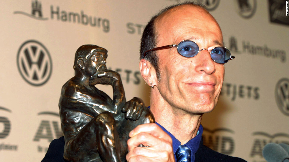 Robin Gibb displays his World Artist Award for Lifetime Achievement during the 2003 World Awards in Hamburg, Germany. Gibb accepted the award on behalf of the Bee Gees.