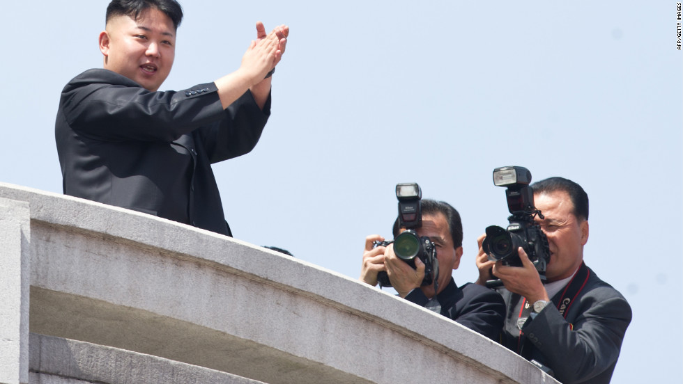 North Korean leader Kim Jong Un, left,  watches a military parade in Pyongyang in honour of the 100th birthday of his grandfather, the late North Korean leader Kim Il Sung. Kim Jong Un spoke before troops and citizens on Sunday as part of the massive, orchestrated celebration.