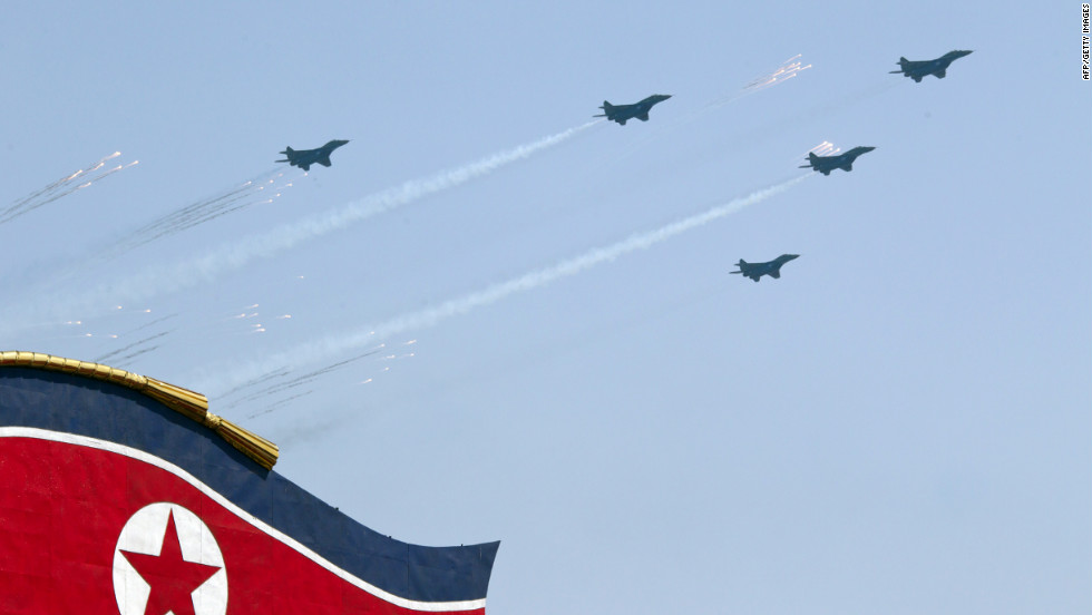 North Korean jet aircraft perform a fly-over during the  parade on Sunday.